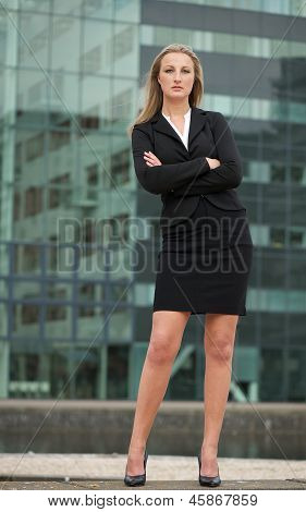 Beautiful Businesswoman Standing Outside Building