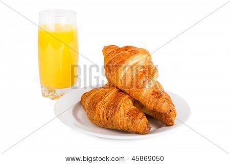 Croissants And Glass Of Orange Juice