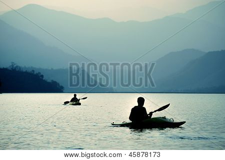 Kayaking At Sunset In The Mountains