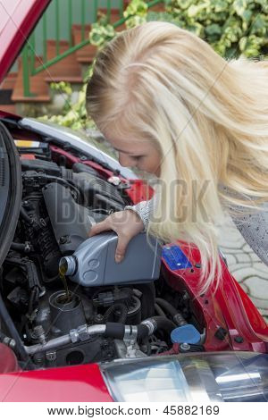 a young woman in her car after filling oil. safe driving at the correct pressure