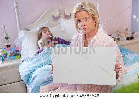 Mother Holds Sign While Daughter Sick In Bed.