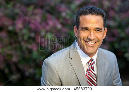 Hispanic Man In Suit Outside