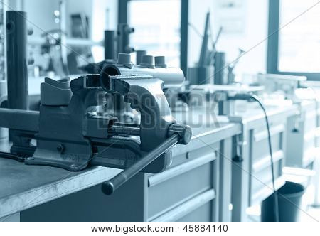 Closeup of bench vice at workroom