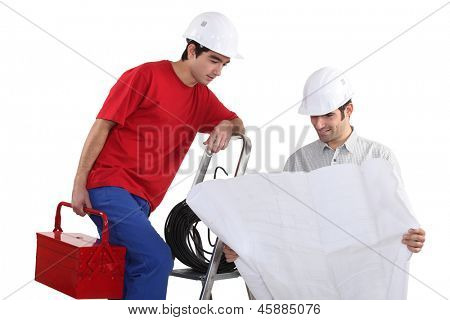 craftsmen looking at a blueprint