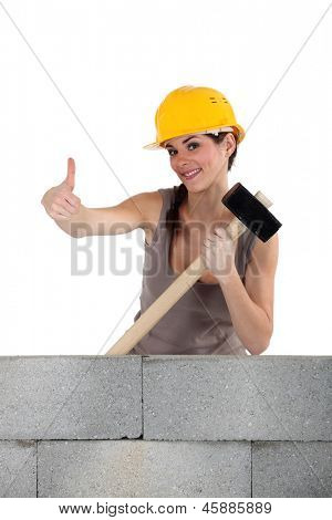 Woman with demolition hammer