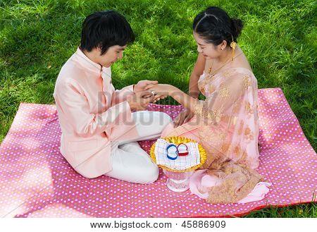 Asian Thai Bridal Wearing Wedding Ring