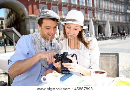 Tourists in Madrid checking on image shots
