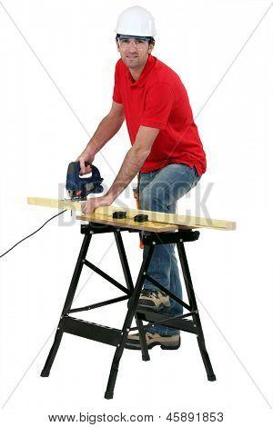 Cabinetmaker cutting wood