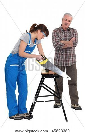 A carpenter and his trainee.