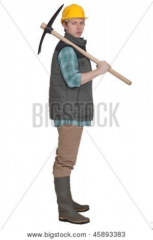 young bricklayer posing with pickaxe