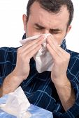 stock photo of blowing nose  - sick man blowing his nose isolated over white - JPG