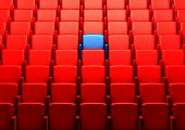 pic of cinema auditorium  - red auditorium with one blue reserved seat - JPG