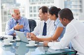 stock photo of coworkers  - Group of business people brainstorming together in the meeting room - JPG