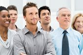 stock photo of diversity  - Successful Business People Standing Together and Looking at Their Bright Future - JPG