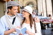 Trendy in love couple visiting European capital