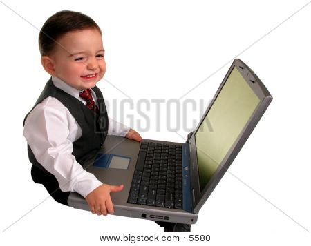 Boy Child In Business Suit On Laptop With Huge Smile