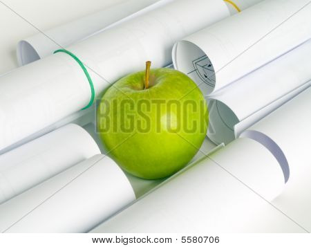 Green Apple And Sheets Of The White Paper In Roll
