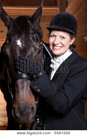 Senior Woman With Her Horse
