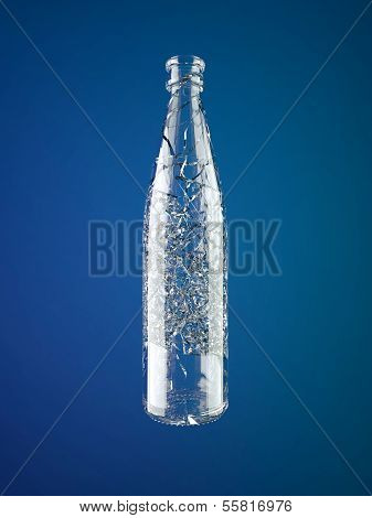 Shattered Empty Glass Bottle Over Blue