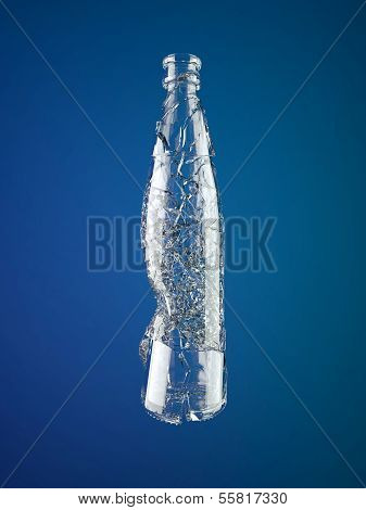 Broken Empty Glass Bottle Over Blue