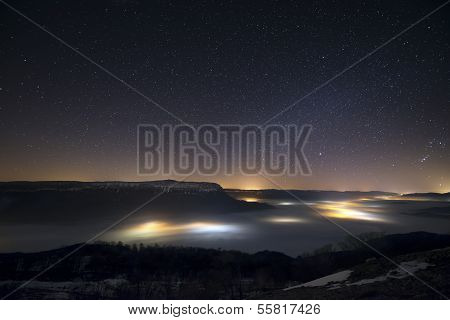 Stars In A Foggy Night Over The Valley