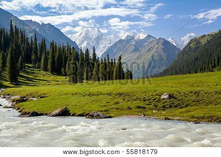 Snowy mountains peak and Karakol river