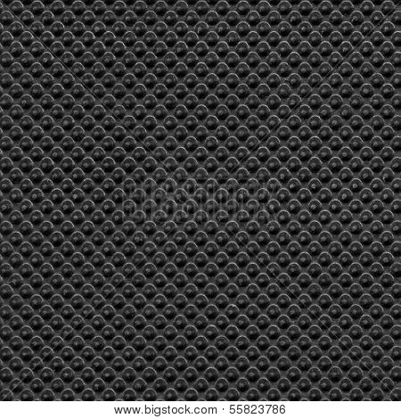 Black rubber texture closeup background.