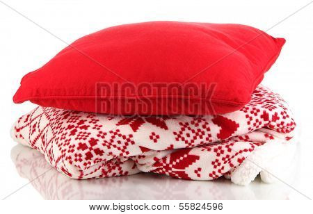 Warm plaid and pillow isolated on white