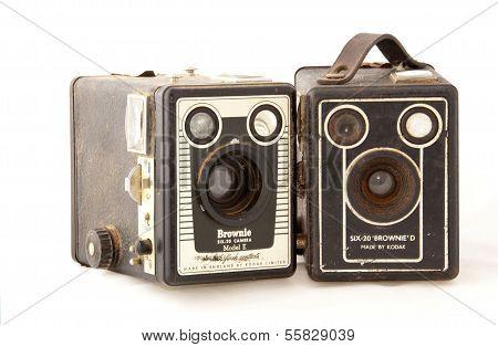 Two Isolated Vintage  Kodak Cameras On White Background