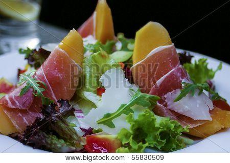 Parma ham served on melon
