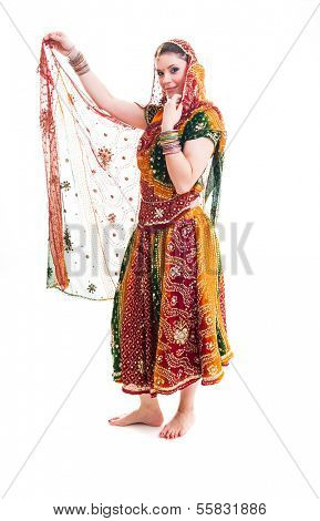 Bollywood dancer in traditional beautiful orange dress