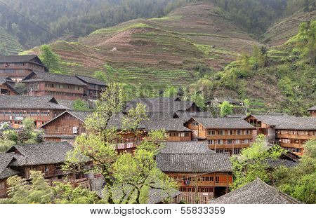 Asia, Rural China, Farmers House On Background Of Rice Terraces.