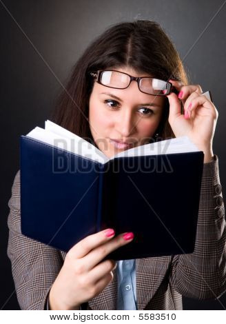 Young School Teacher Reading A Book
