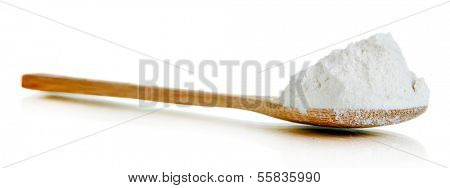 Starch in spoon isolated on white