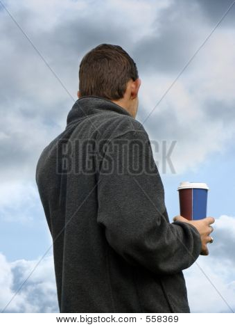 Young Man Holding A Cup Of Coffee