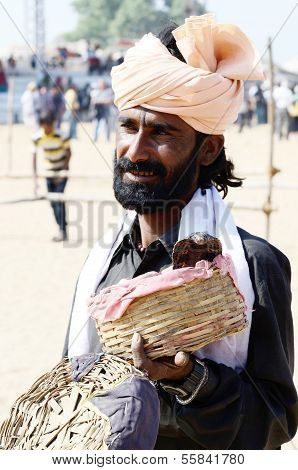 Snake charmer perform at annual camel fair,Pushkar,India