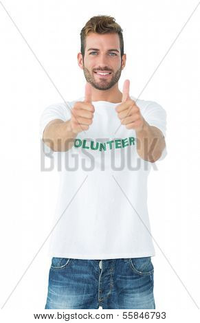 Portrait of a happy male volunteer gesturing thumbs up over white background