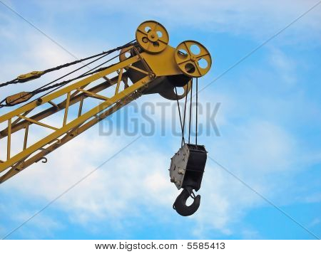 Building Crane Detail Against Blue Sky