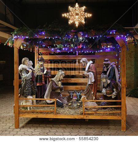Christmas Nativity Scene with Three Wise Men Presenting Gifts to Baby Jesus, Mary and Joseph