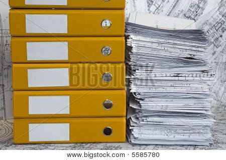 Heap Of Project Drawings In Yellow Folder.