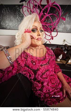 Blond Drag Queen Sitting