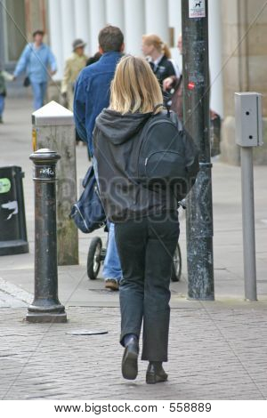 Blond Woman Shopping With Backpack