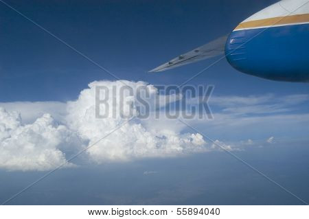 Airplane Flying Above The Clouds