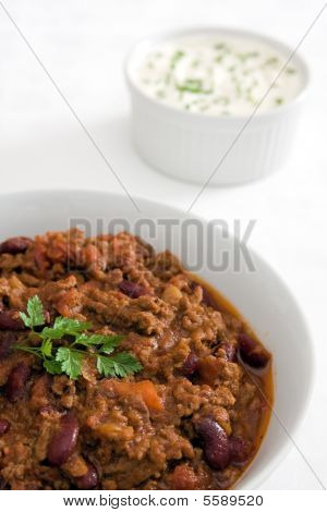Chilli Con Carne With Sour Cream And Chives In Background