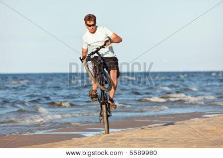 Young Man Doing Wheelie