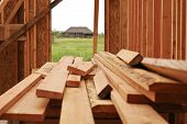 foto of 2x4  - New construction lumber for a house frame
