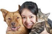stock photo of cat dog  - Woman hugging her dog and cat - JPG