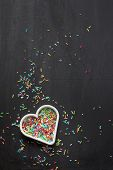 image of sprinkling  - Heart shaped cookie cutter with candy sprinkles - JPG