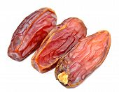 image of circumcision  - dry date palm fruits on white background