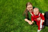 Mother And Toddler On Grass
